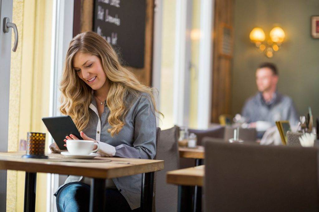 Woman orders from allergen menu in a cafe